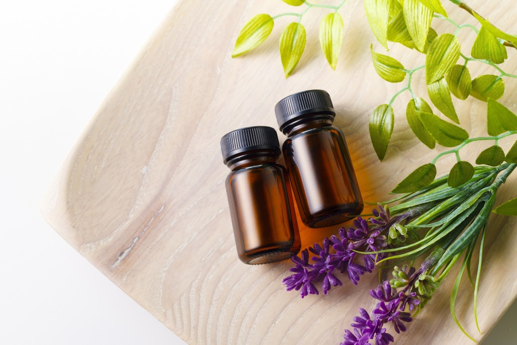 BEAUTIFUL ESSENTIAL OILS in amber bottles and plants
