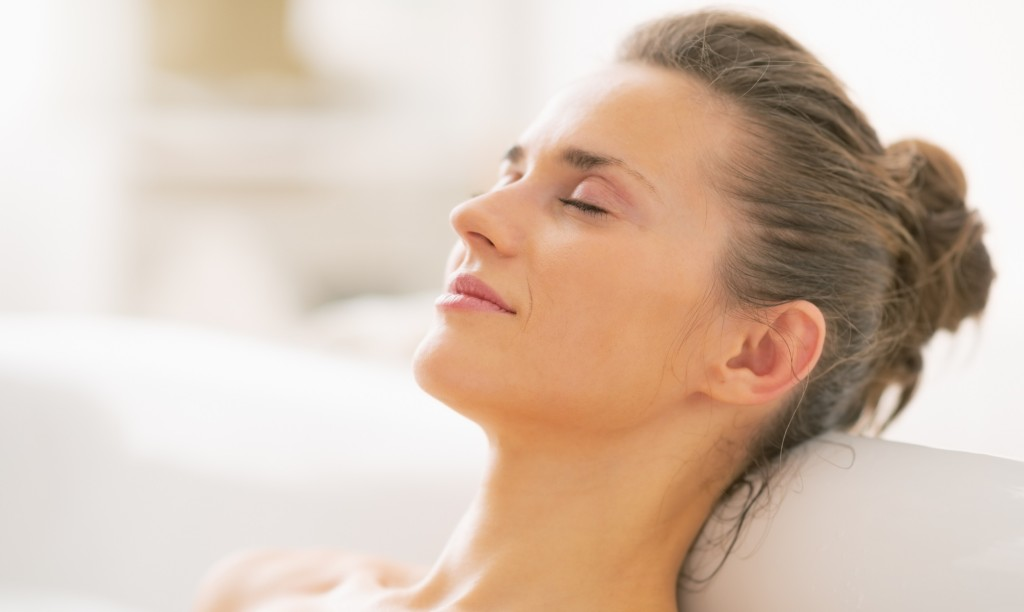 Portrait of relaxed young woman in bathtub