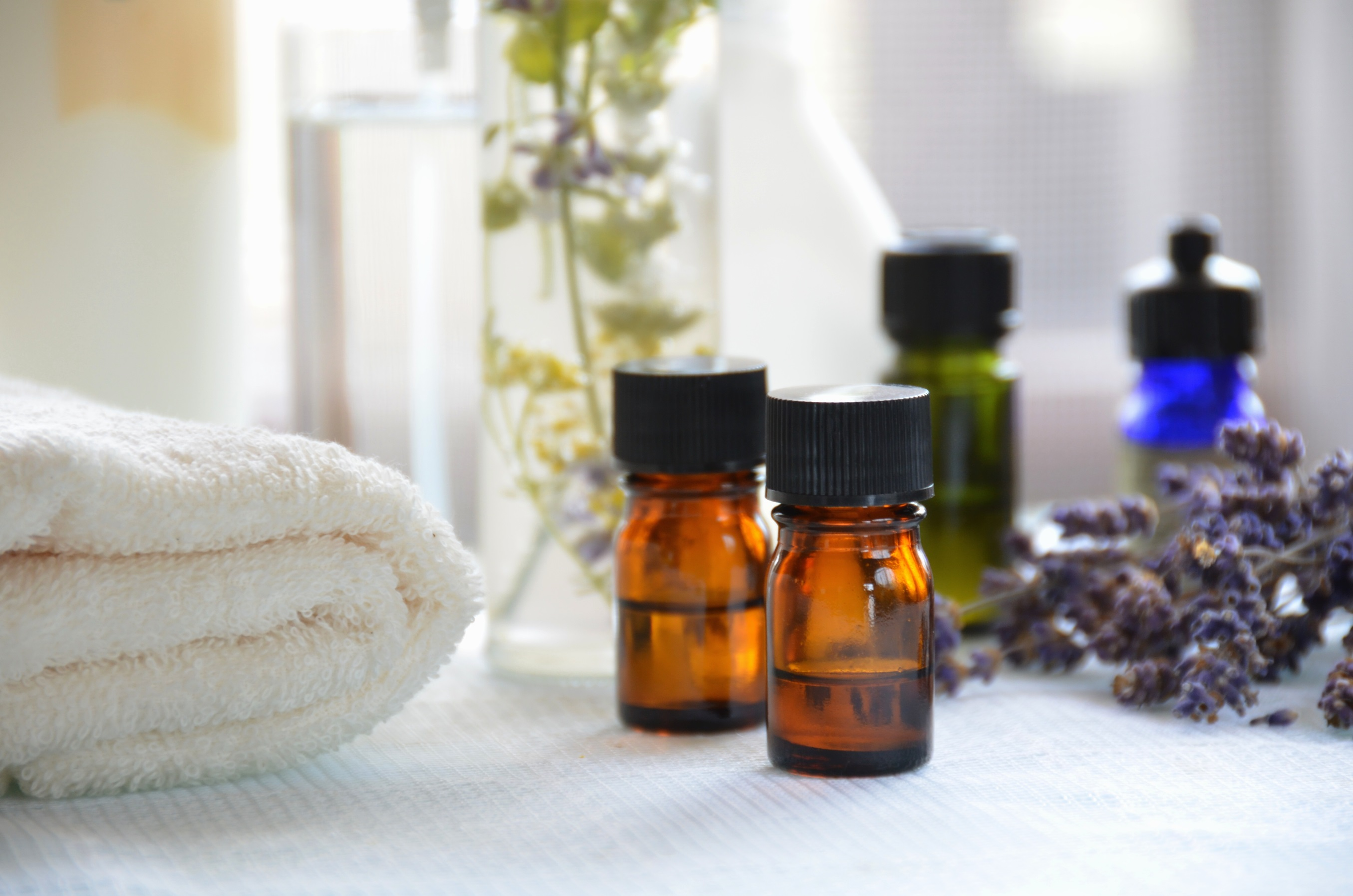 various essential oils and towel